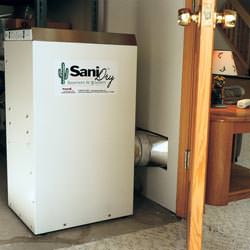 A basement dehumidifier with an ENERGY STAR® rating ducting dry air into a finished area of the basement  in Toano