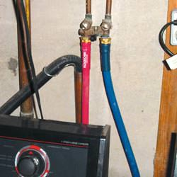 Washer hoses in a basement  in Charles City